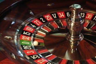 The 8 billion dollar gamble - roulette wheel image for article by Greg Alder